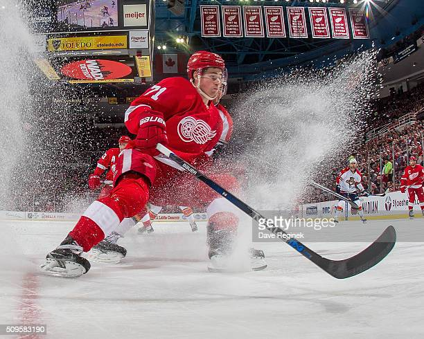 Dylan Larkin of the Detroit Red Wings stop and follows the play during an NHL game against the Florida Panthers at Joe Louis Arena on February 8 2016...