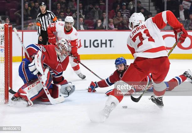 Dylan Larkin of the Detroit Red Wings tries to score against the Montreal Canadiens in the NHL game at the Bell Centre on December 2 2017 in Montreal...