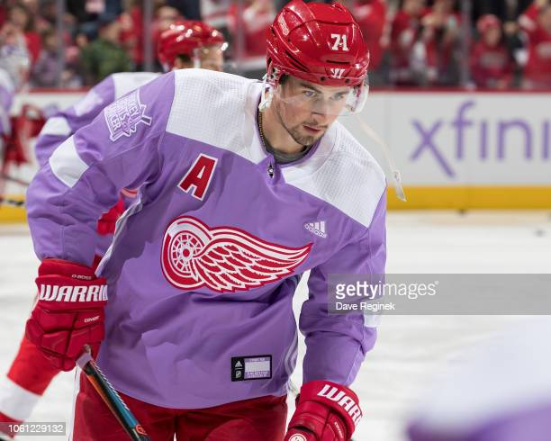 Dylan Larkin of the Detroit Red Wings wears a purple jersey for Hockey Fights Cancer night during warm-ups prior to an NHL game against the Arizona...