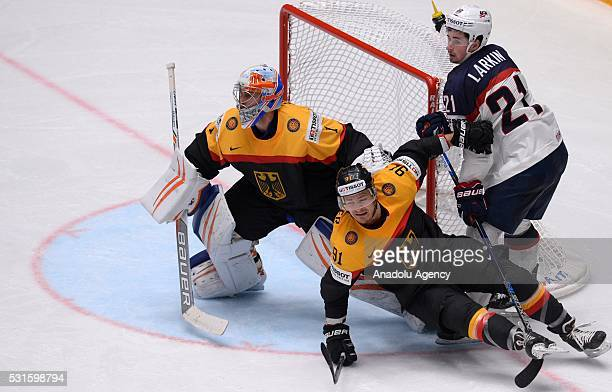 Dylan Larkin of USA vies with Thomas Greiss and Moritz Muller of Germany during IIHF Ice Hockey World Championship Group B preliminary round game...