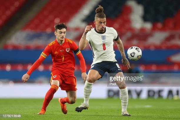 Dylan Levitt of Wales battles for possession with Kalvin Phillips of England during the international friendly match between England and Wales at...