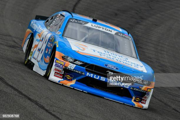 Dylan Lupton driver of the thinQ Technology Partners Ford drives during practice for the NASCAR Xfinity Series Roseanne 300 at Auto Club Speedway on...
