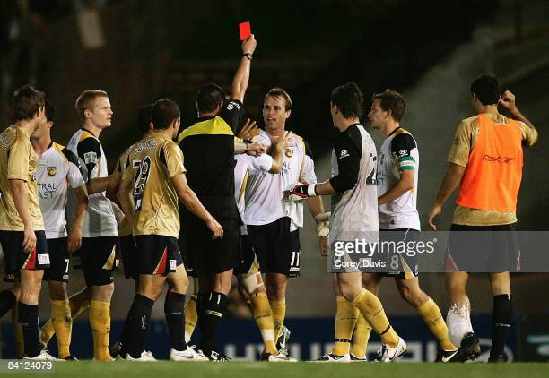 Dylan Macallister of the Mariners recieves a red card after the round 17 ALeague match between the Newcastle Jets and the Central Coast Mariners at...