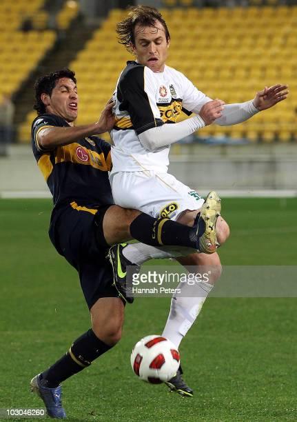 Dylan MacAllister of the Phoenix competes with Juan Insaurralde of Boca Juniors during the preseason friendly match between Wellington Phoenix and...