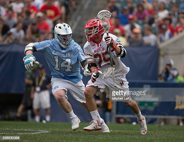 Dylan Maltz of the Maryland Terrapins controls the ball against William McBride of the North Carolina Tar Heels in the NCAA Division I Men's Lacrosse...