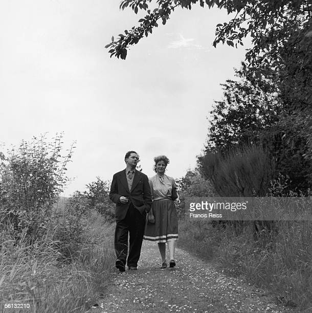 Dylan Marlais Thomas Welsh poet shortstory writer and playwright walking with his wife Caitlin 10th August 1946 Original Publication Picture Post...