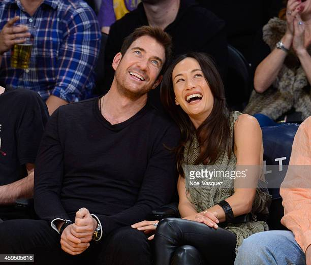 Dylan McDermott and Maggie Q attend a basketball game between the Denver Nuggets and the Los Angeles Lakers at Staples Center on November 23 2014 in...