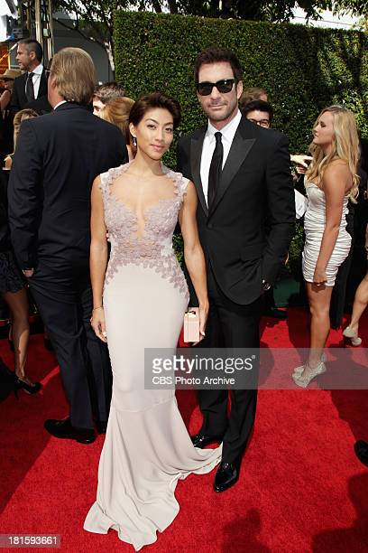 Dylan McDermott and Shasi Wells on the red carpet for the 65th Primetime Emmy Awards which will be broadcast live across the country 8001100 PM ET/...