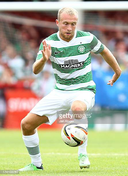 Dylan McGeouch of Celtic controls the ball during a pre season friendly match between Brentford and Celtic at Griffin Park on July 20 2013 in...