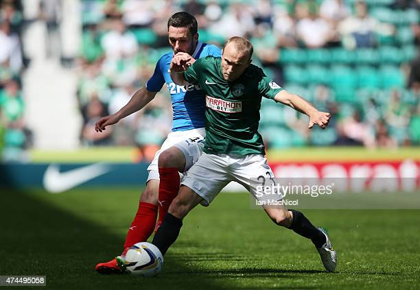Dylan McGeouch of Hibernian vies with Nicky Law of Rangers controls the ball during the Scottish Championship play off semi final second leg match...