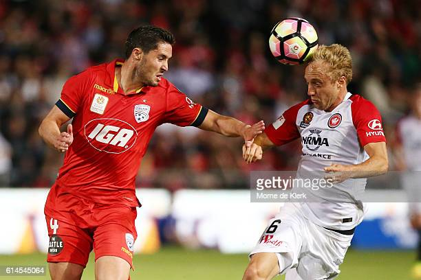 Dylan McGowan of Adelaide United competes with Mitch Nicolls of the Wanderers during the round two ALeague match between Adelaide United and the...