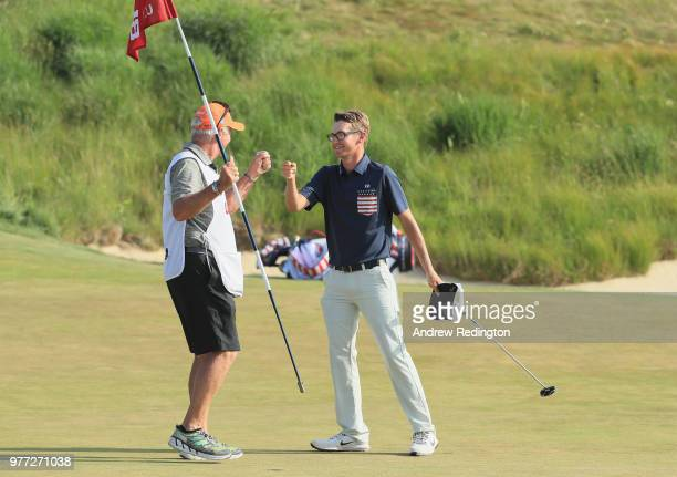 Dylan Meyer of the United States fist bumps caddie Steve Hulka on the 18th green during the final round of the 2018 US Open at Shinnecock Hills Golf...