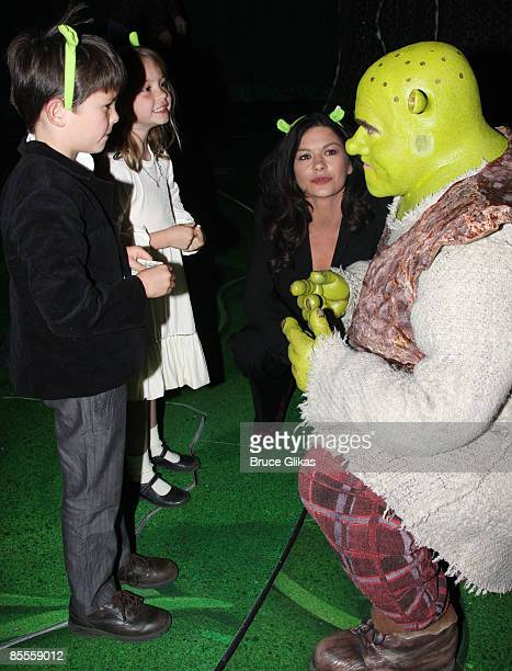 Dylan Michael Douglas Carys Zeta Douglas Catherine ZetaJones and Brian d'Arcy James as Shrek pose backstage at ShrekThe Musical on Broadway at the...