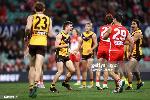 Dylan Moore of the Hawks celebrates kicking a goal with team mates during the round 13 AFL match between the Sydney Swans and the Hawthorn Hawks at...
