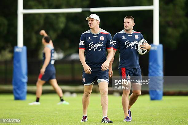 Dylan Napa and Shaun Kenny-Dowall warm up during a Sydney Roosters NRL training session at Moore Park on April 12, 2016 in Sydney, Australia.