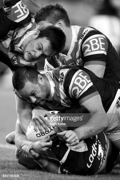 Dylan Napa Luke Keary and Boyd Cordner of the Roosters tackle Kodi Nikorima of the Broncos during the NRL Qualifying Final match between the Sydney...