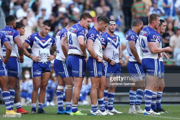 Dylan Napa of the Bulldogs and team mates look dejected during the round four NRL match between the Canterbury Bulldogs and the South Sydney...