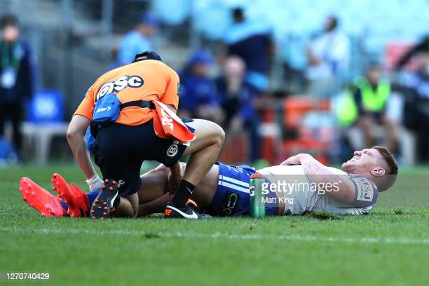 Dylan Napa of the Bulldogs is attended to by a trainer after an injury during the round 17 NRL match between the Canterbury Bulldogs and the Gold...