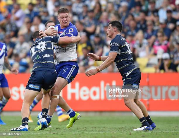 Dylan Napa of the Bulldogs is tackled by Mitch Dunn of the Cowboys during the round six NRL match between the North Queensland Cowboys and the...