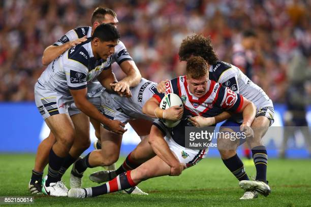 Dylan Napa of the Roosters is tackled during the NRL Preliminary Final match between the Sydney Roosters and the North Queensland Cowboys at Allianz...