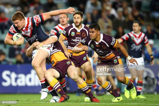 Dylan Napa of the Roosters is tackled during the NRL Qualifying Final match between the Sydney Roosters and the Brisbane Broncos at Allianz Stadium...