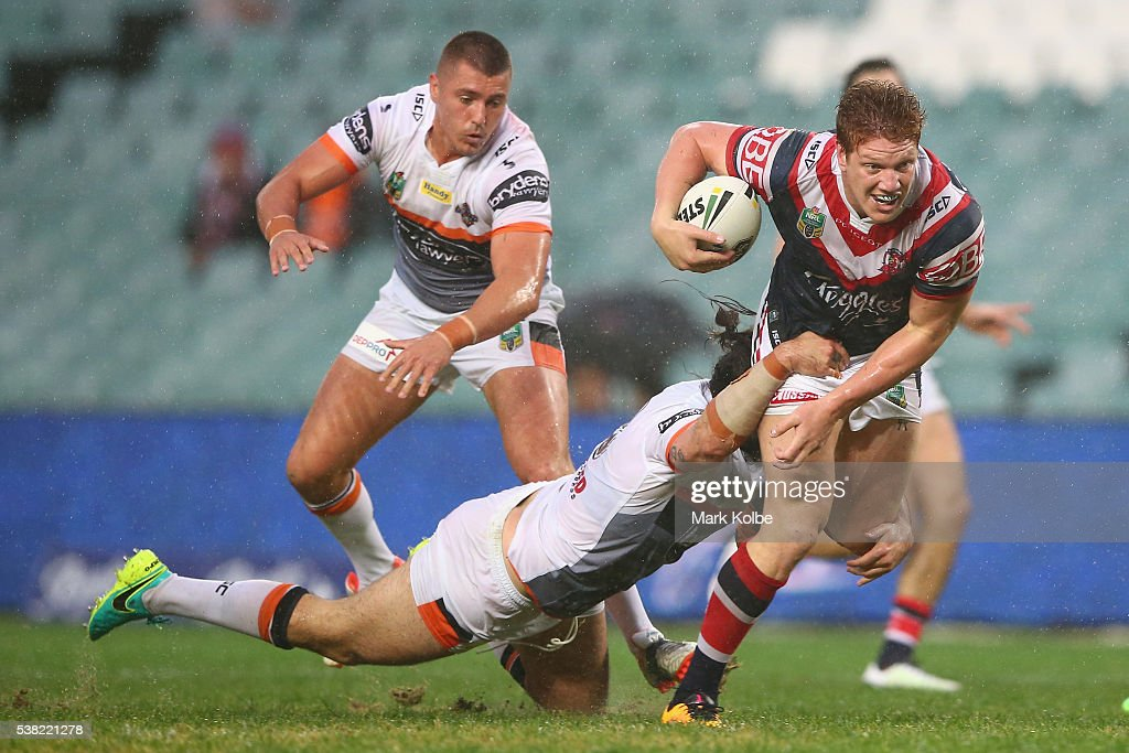 Dylan Napa of the Roosters is tackled during the round 13 NRL match between the Sydney Roosters and the Wests Tigers at Allianz Stadium on June 5, 2016 in Sydney, Australia.
