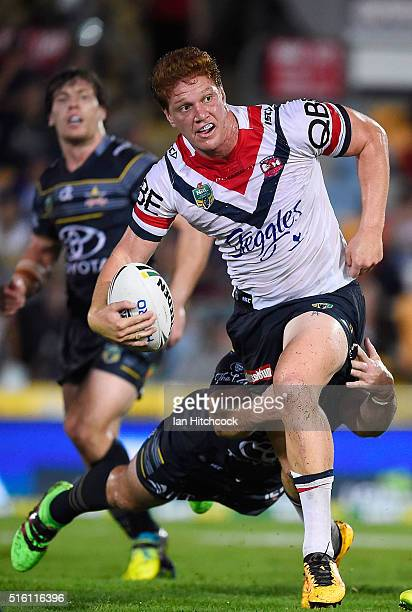 Dylan Napa of the Roosters looks to get a pass away during the round three NRL match between the North Queensland Cowboys and the Sydney Roosters at...