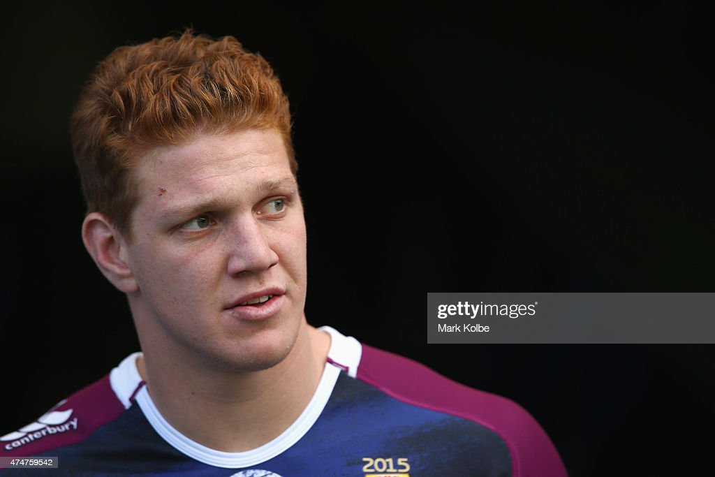 Dylan Napa walks out to the field for a Queensland Maroons State of Origin training session at ANZ Stadium on May 26, 2015 in Sydney, Australia.