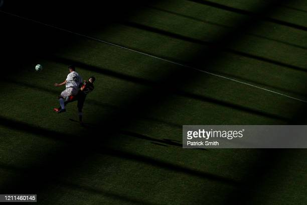 Dylan Nealis of Inter Miami and Joseph Mora of D.C. United battle for a head ball during the first half at Audi Field on March 7, 2020 in Washington,...