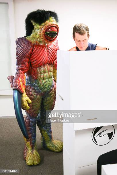 Dylan Nicholson dressed in World of WearableArt garment 'Watcher in the Water' by Craig McMillan of New Zealand votes at Wellington City Library on...
