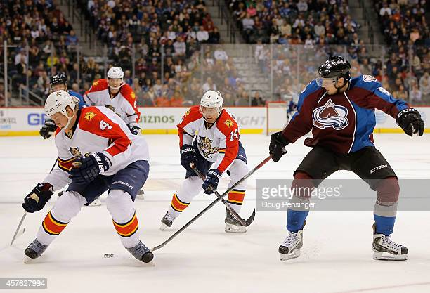 Dylan Olsen of the Florida Panthers and Matt Duchene of the Colorado Avalanche look to take control of the puck at Pepsi Center on October 21 2014 in...