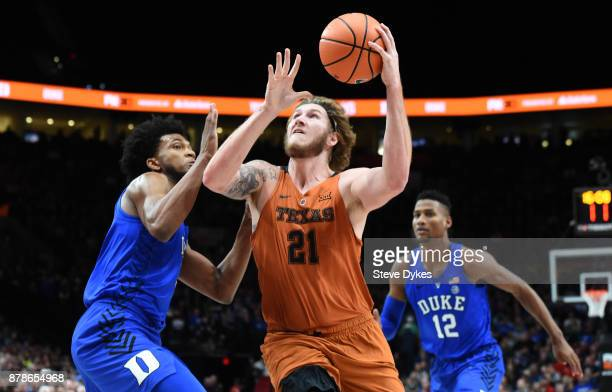 Dylan Osetkowski of the Texas Longhorns drives to the basket on Marvin Bagley III of the Duke Blue Devils during the first half of the game during...