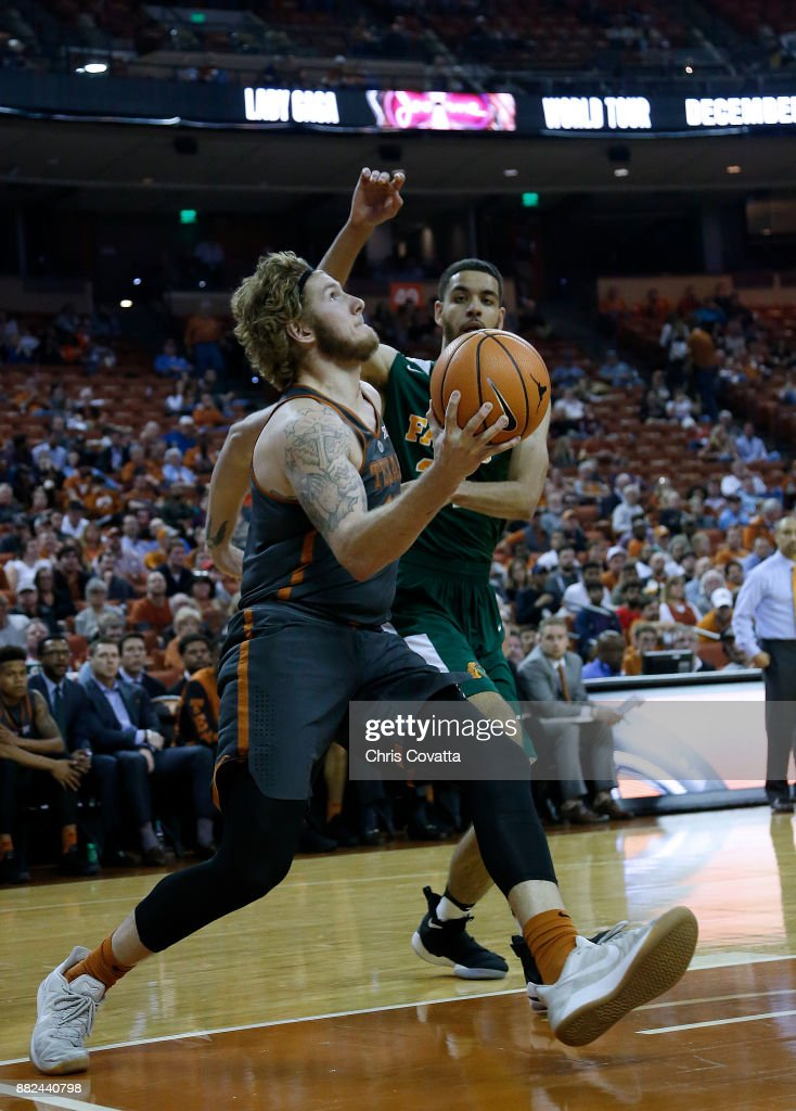 Dylan Osetkowski #21 of the Texas Longhorns moves the hoop against the Florida A&M Rattlers at the Frank Erwin Center on November 18, 2017 in Austin, Texas.