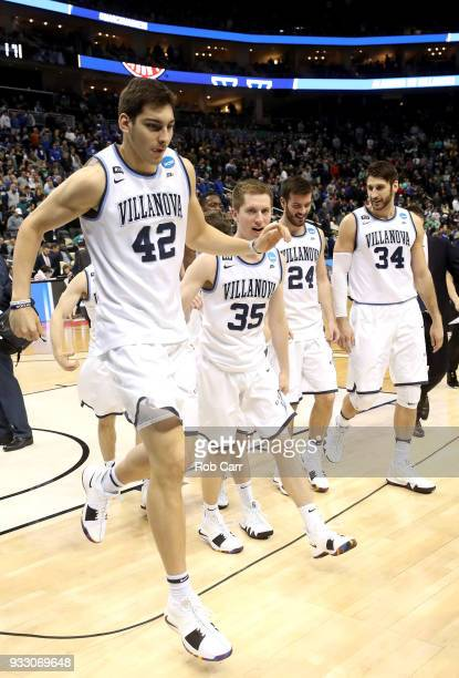 Dylan Painter Matt Kennedy Tom Leibig and Tim Delaney of the Villanova Wildcats react after defeating the Alabama Crimson Tide in the second round of...