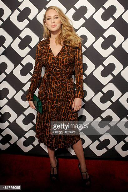 Dylan Penn arrives at Diane Von Furstenberg's Journey Of A Dress premiere opening party at Wilshire May Company Building on January 10 2014 in Los...