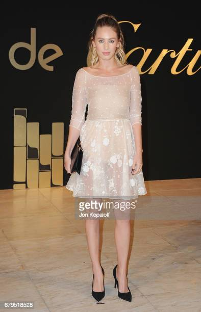 Dylan Penn arrives at the Panthere De Cartier Party In LA at Milk Studios on May 5 2017 in Los Angeles California