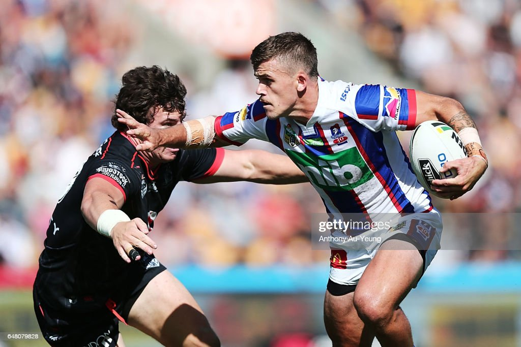 Dylan Phythian of the Knights on the charge against Charlie Gubb of the Warriors during the round one NRL match between the New Zealand Warriors and the Newcastle Knights at Mt Smart Stadium on March 5, 2017 in Auckland, New Zealand.