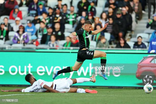 Dylan Pierias of Western United is tackled by Gregory Wuthrich of the Glory during the round two A-League match between Western United and Perth...