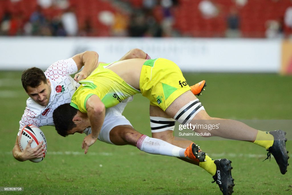 Dylan Pietsch of Australia tackles Oliver Lindsay-Hague of England during the 2018 Singapore Sevens Cup Semi Final match between Australia and England at National Stadium on April 29, 2018 in Singapore.