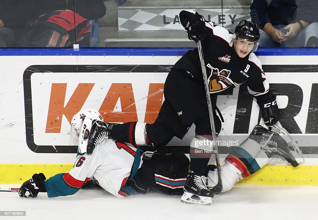 Dylan Plouffe #6 of the Vancouver Giants checks Kole Lind #16 of the Kelowna Rockets during the third period of their WHL game at the Langley Events Centre on November 4, 2016 in Langley, British Columbia, Canada.