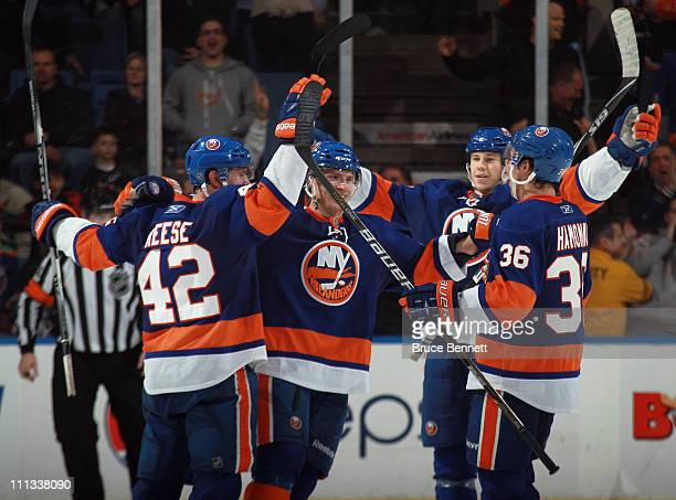 Dylan Reese Blake Comeau Matt Martin and Travis Hamonic of the New York Islanders celebrate a goal at 1400 of the third period by Trevor Gillies of...