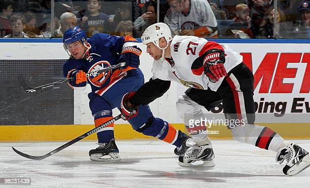 Dylan Reese of the New York Islanders fires the puck past Alex Kovalev of the Ottawa Senators for a second period goal on April 3 2010 at Nassau...