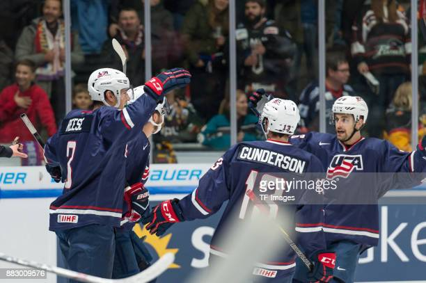 Dylan Reese of USA Ryan Gunderson of USA and Jonathan Blum of USA celebrate thier team`s second goal during the Deutschland Cup 2017 match between...