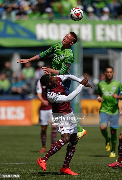 Dylan Remick of the Seattle Sounders FC battles Edson Buddle of the Colorado Rapids at CenturyLink Field on April 26 2014 in Seattle Washington