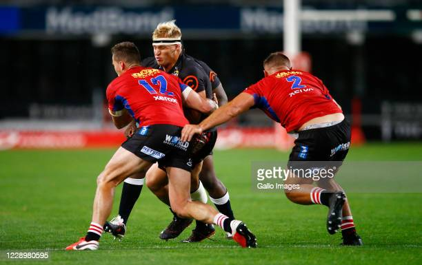 Dylan Richardson of the Cell C Sharks is tackled by Dan Kriel of the Emirates Lions during the Super Rugby Unlocked match between Cell C Sharks and...