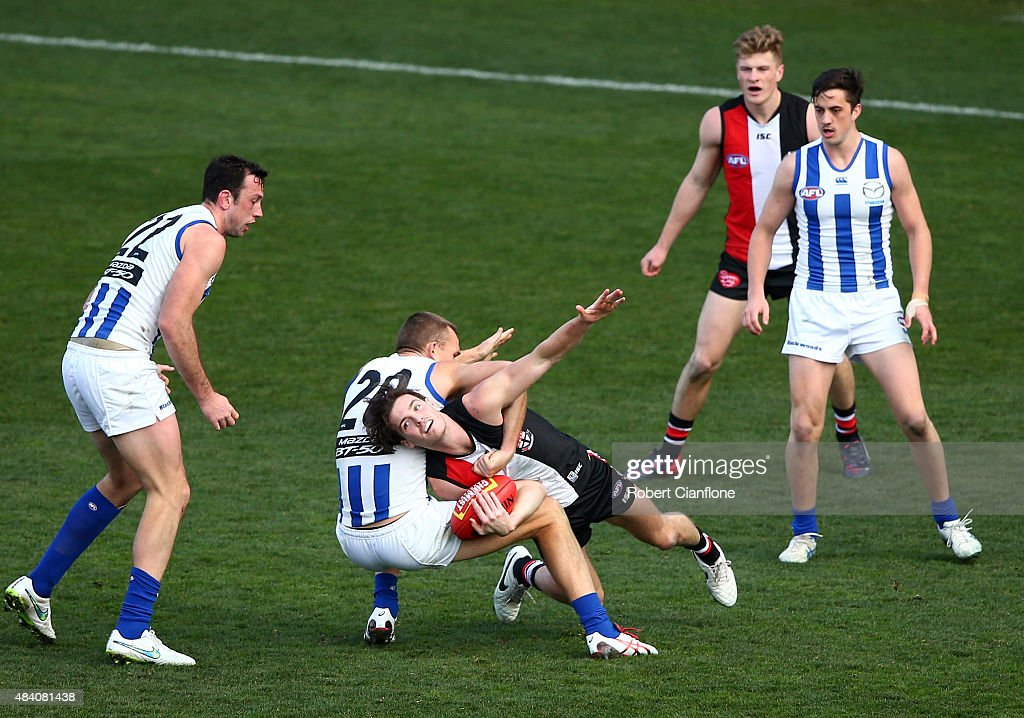 Dylan Roberton of the Saints is challenged by Drew Petrie of the Kangaroos during the round 20 AFL match between the North Melbourne Kangaroos and the St Kilda Saints at Blundstone Arena on August 15, 2015 in Hobart, Australia.