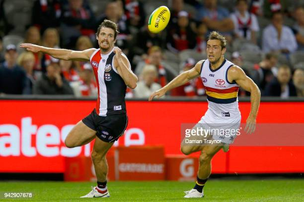 Dylan Roberton of the Saints Richard Douglas of the Adelaide Crows chase the ball during the round three AFL match between the St Kilda Saints and...