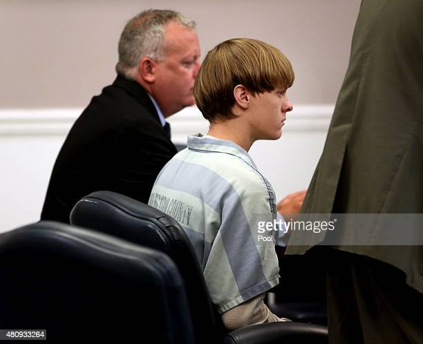 Dylan Roof the suspect in the mass shooting that left nine dead in a Charleston church last month appears in court accompanied by assistant defensive...