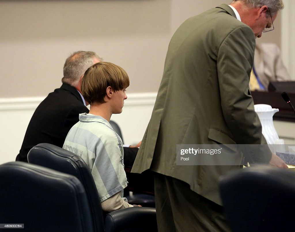 Dylan Roof (C), the suspect in the mass shooting that left nine dead in a Charleston church last month, appears in court accompanied by chief public defender Ashley Pennington (R) and assistant defensive attorney William Maguire July 18, 2015 in Charleston, South Carolina. The Associated Press, WCIV-TV and The Post and Courier of Charleston are challenging a judge's order issued last week that prohibits the release of public records in the June 17 shooting at Emanuel African Methodist Episcopal church.