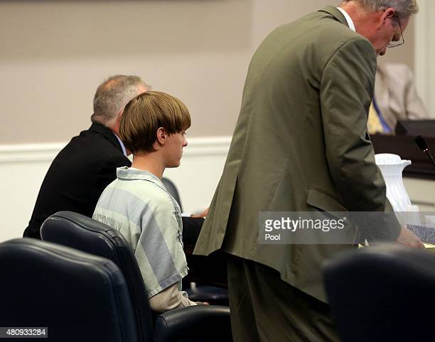 Dylan Roof the suspect in the mass shooting that left nine dead in a Charleston church last month appears in court accompanied by chief public...